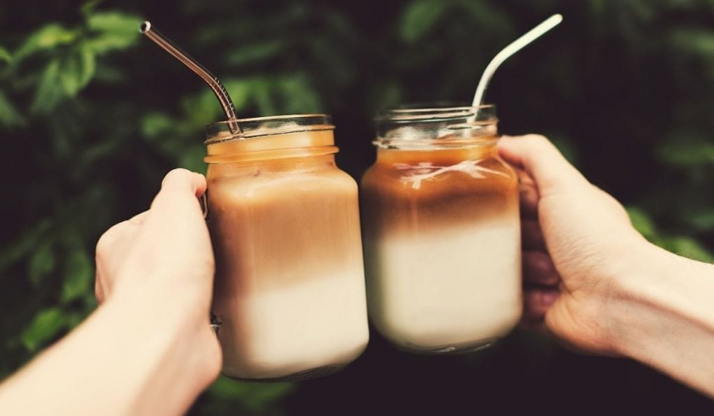 iced coffee in a jar with stainless steel straws