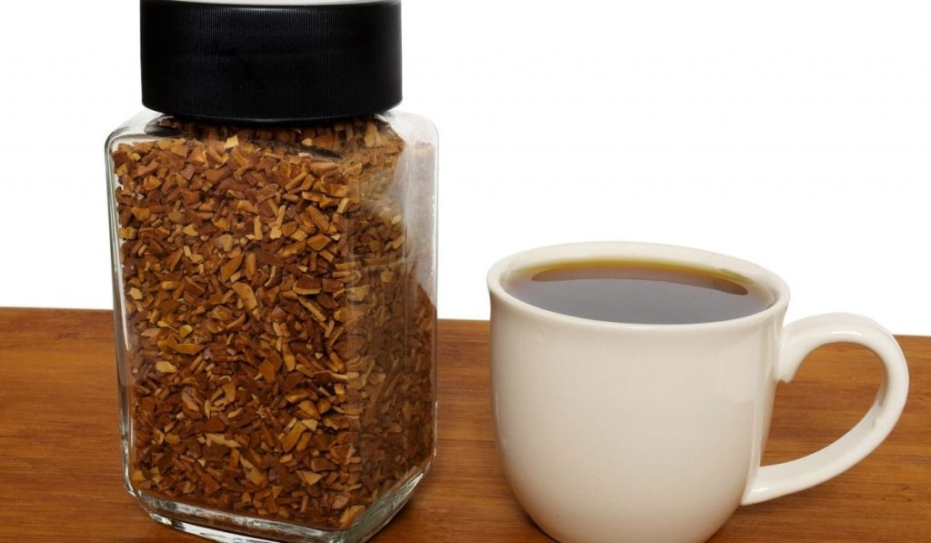 instant coffee in a jar and cup